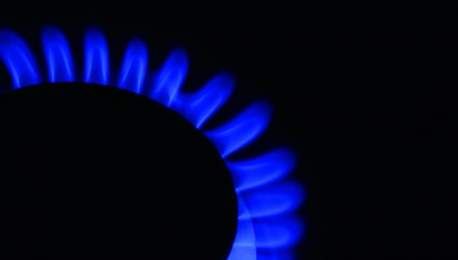 Blue natural gas flame on a black background